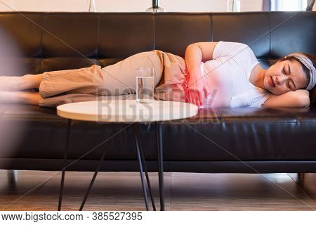 Asian Woman Having Painful Stomach Ache,female Suffering From Abdominal Pain,period Cramps Or Premen