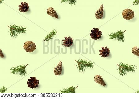 Seamless Christmas Pattern From Pine Cones On Green Background. Modern Pine Cone Christmas Collage.