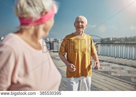 Senior Male Smiling At His Wife Outdoors