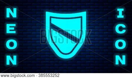 Glowing Neon Shield Icon Isolated On Brick Wall Background. Guard Sign. Security, Safety, Protection