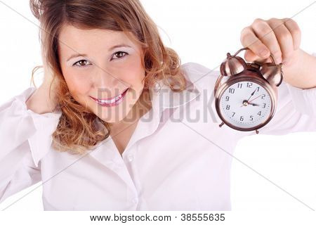 Awakening woman in white holds alarm clock isolated on white background.