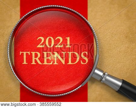 2021 Trends Through Magnifying Glass On Old Paper With Red Vertical Line Background.