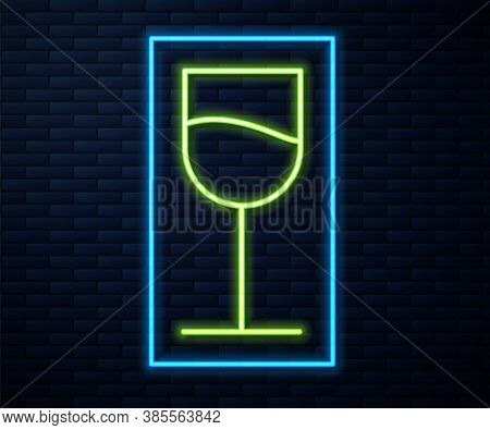 Glowing Neon Line Wine Glass Icon Isolated On Brick Wall Background. Wineglass Sign. Vector Illustra
