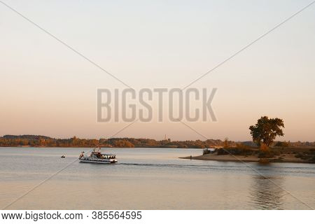 Fisher Boat In The River With Sunset