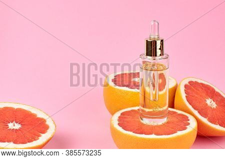 Citrus Essential Oil With Fresh Grapefruit Slices. Aromatherapy.