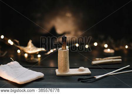 Natural Elements For Spiritual Practices. Burning Palo Santo Wood Sticks On Black Background. Balanc