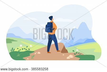 Active Tourist Hiking In Mountain. Man Wearing Backpack, Enjoying Trekking, Looking At Snowcapped Pe