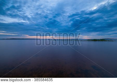 Blue Tranquil Minimalist Landscape With Smooth Surface Of The Lake With Calm Water With Horizon Unde