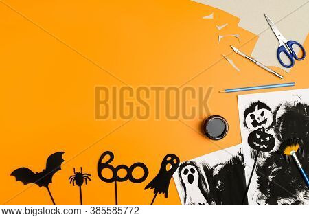 Preparing For Halloween. Handmade Crafts. Top View Of Paper Decorations For Halloween Party On Orang