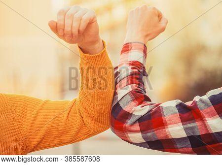 Closeup Elbow Bump. Elbows Bump. Health Care Concept. Social Distancing. Two People Bump Elbows To A