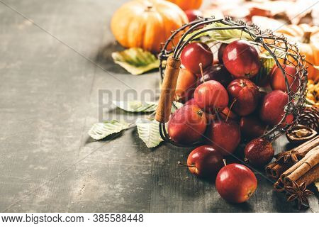 Apples In Basket On Old Wooden Background, Space For Text