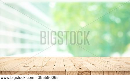 Empty Wood Table Top On Blur Abstract Green Garden From Window View Background.for Montage Product D