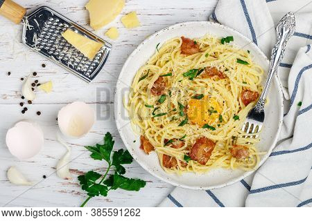 Pasta Carbonara. Spaghetti With Bacon, Egg, Parsley And Parmesan Cheese Sauce In A White Plate On A