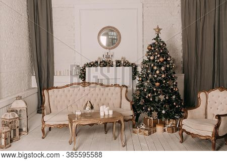 Christmas Decor. Christmas Tree Decorations And Holiday Homes. New Years Interior With A Fir Tree In