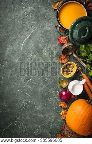 Pumpkin soup on green vintage background