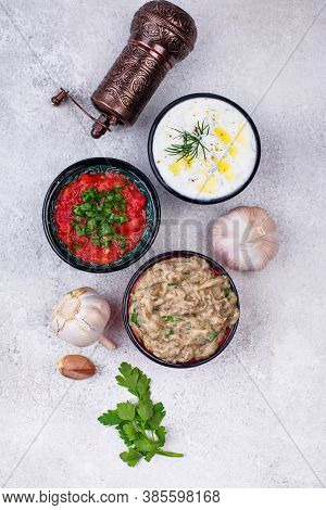 Traditional Turkish Or Arabian Meze Sauces. Eggplant Dip Baba Ganoush, Tzatziki And Tomato Ezme