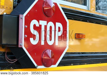 Stop Sign On The Side Of A School Bus