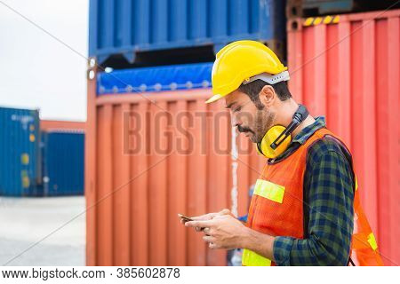 Engineer Man Uses Mobile Phone, Industrial Worker Using Mobile Smartphone In Industry Containers Car