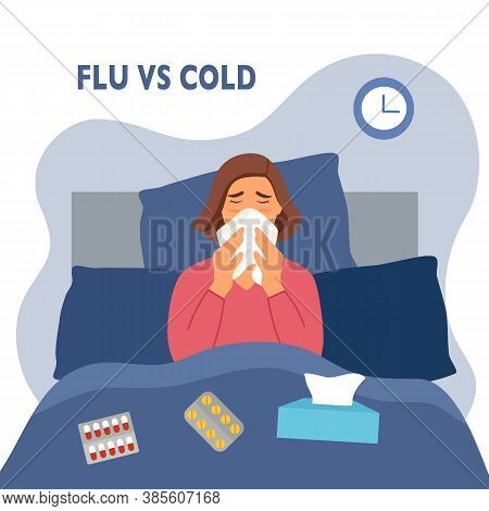 Woman Suffering From Flu In Bed Under Blanket. She Has Fever And Sneezing In Tissue Paper Or Napkin.