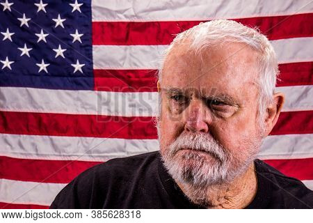 Angry Vietnam Vet Looking Away Suspiciously With American Flag Background