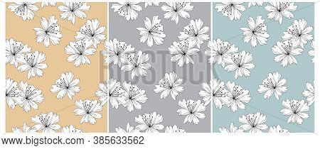 Abstract Irregular Floral Seamless Vector Patterns. Hand Drawn Flowers On A Pastel Blue, Pale Yellow