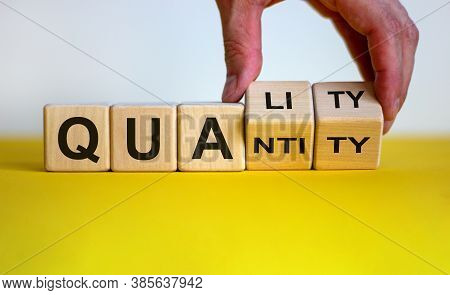 Quality Over Quantity. Hand Turns Cubes And Changes The Word 'quantity' To 'quality'. Beautiful Yell