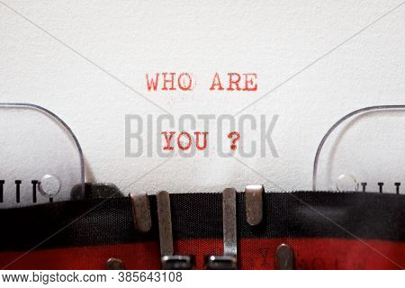 Who are you question written with a typewriter.
