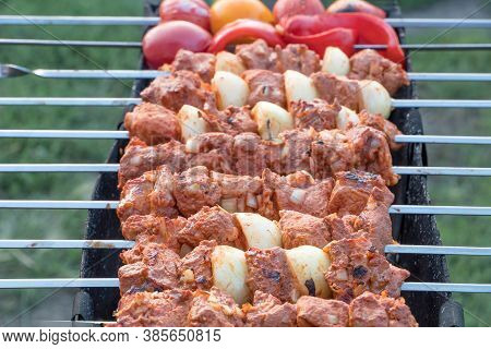 Photo Cooking Fry Shish Kebab,bbq, Barbecue, Shashlik Or Meat On Coals. Cooking Meat In The Grill On