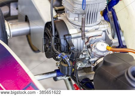 Close Up Carburetor And Cable Choke Assembly With Body And Cylinder Head Of 2 Stroke Engine Of Sport