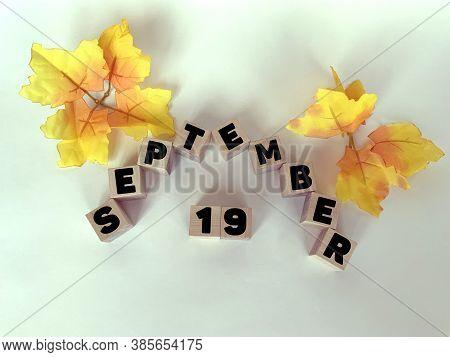 September 19  On Wooden Cubes On A White Background .calendar For September.autumn