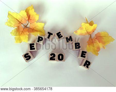 September 20  On Wooden Cubes On A White Background .calendar For September.autumn