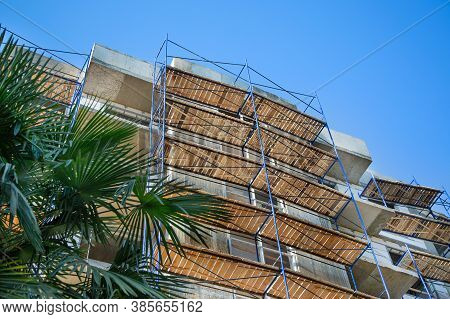 Scaffolding At A Building Under Construction. Assembly Scaffolding. Assembly Scaffolding.