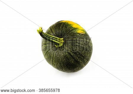 Green Pumpkin With Yellow Tinge Isolated On White Background. View From Above. Autumn Concept.