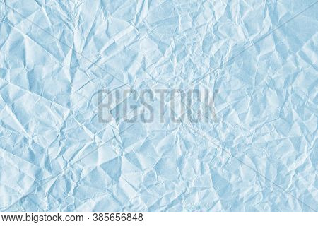 Background Is Blue. Texture Of Blue Paper With Kinks And Dents, Old And Dilapidated.