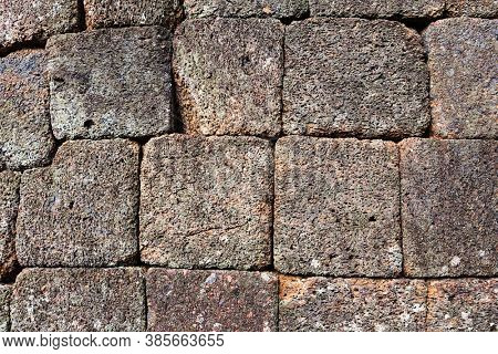 brick wall of sandstone as background