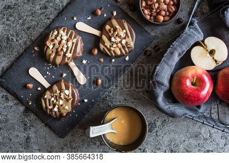 Apple Popsicle Dipped In Chocolate And Caramel, Studded With Hazelnuts