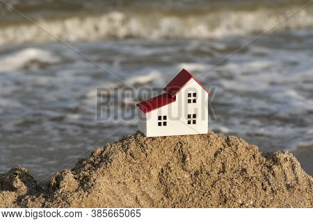 Small House On Sea Background. House By The Sea Concept. Villas For Sale, Houses