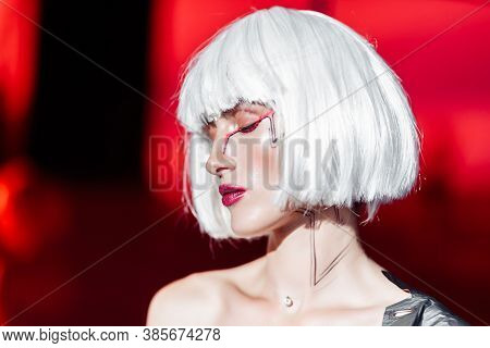 Blonde On A Red Background With Stylish Clothes. Cyberpunk Style