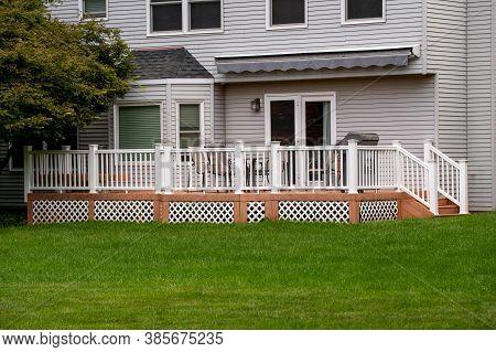 House With A Veranda And A White Fence Porch Building