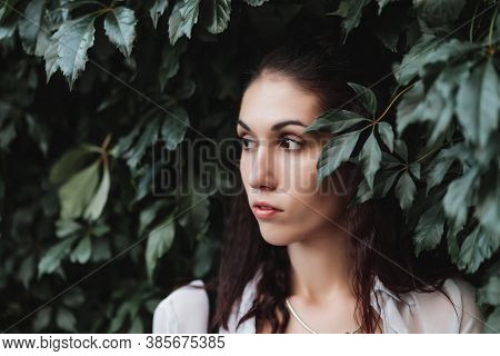Portrait Of A Woman In The Bushes