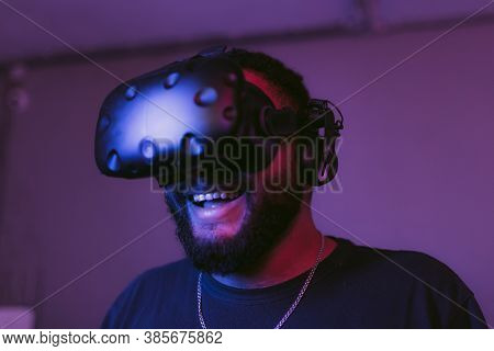 The Guy Is Playing Vr Games. Neon Blue Light.