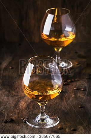 Armagnac, French Grape Brandy, Strong Alcoholic Drink. Still Life In Vintage Style With Cigar Smoke,