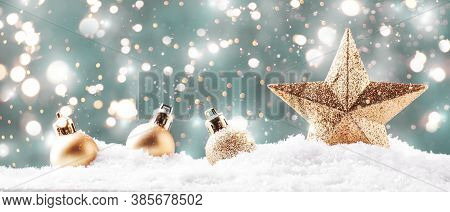 Christmas Background With Golden Star. New Year's Decor. Christmas Balls In Smowdrifts And Golden Bo