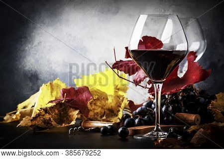 Dry Red Wine In Wine Glass, Fall Still Life With Red And Yellow Leaves, Wine Degustation, Rustic Sty