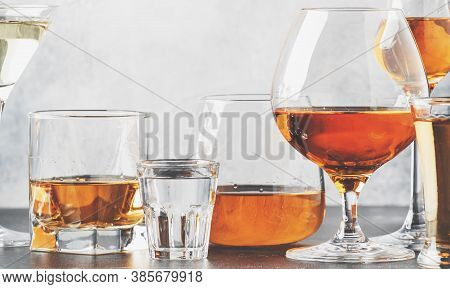 Set Of Hard Strong Alcoholic Drinks And Spirits In Glasses In Assortment: Vodka, Cognac, Tequila, Br