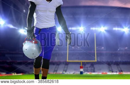 American Football Player  Holding Helmet With Bright Spotlights In Background