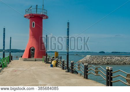 Seosan-si, South Korea; August 28, 2020: For Editorial Use Only. Closeup Of Red Lighthouse On End Of