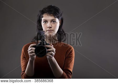 Portrait Of A Female Online Content Creator Holding A Video Camera Used For Vlogging.  She Is An Ama