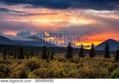 Beautiful View Of Canadian Nature Landscape During A Dramatic Cloudy Sunset. Taken Near Whitehorse,