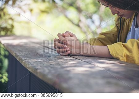 Prayer And Bible Concept.asian Female Praying,hope For Peace And Free From Coronavirus,hand In Hand